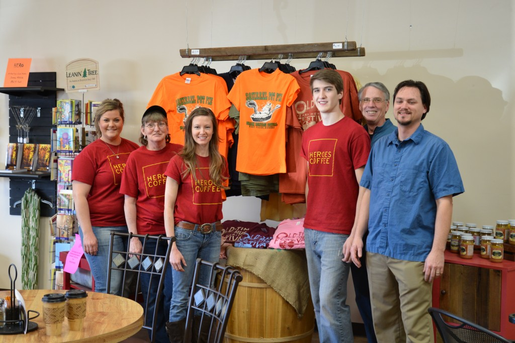 T-SHIRTS FOR THE OLD-TIME MUSIC, Ozark Heritage Festival are now available year round at Heroes Coffee Café and the Ozark Heritage Welcome Center, both in West Plains.  With the festival T-shirt display at Heroes Coffee Café are, from left Felicia Trayler, Doris Gutierrez, Mandi Rohlfsen and Bryce Mossman of Heroes and festival volunteers Mark Basom and Josh Shirley.